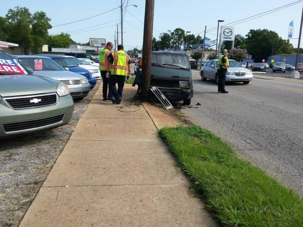 Car vs Two Poles on South Oates
