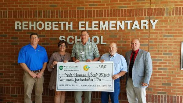Wiregrass Electric Cooperative's Operation Roundup presented a check to the  Rehobeth Elementary School Beta Club