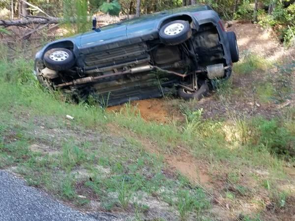 8:15 AM... Vehicle Over Turned on Iris Road