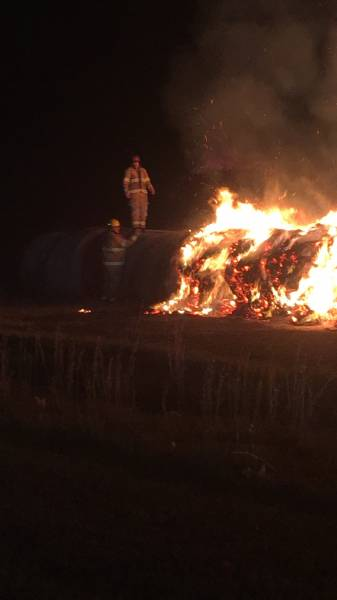 9:01 PM. Pansey Volunteer Fire On Scene With Multiple Hay Bales On Fire