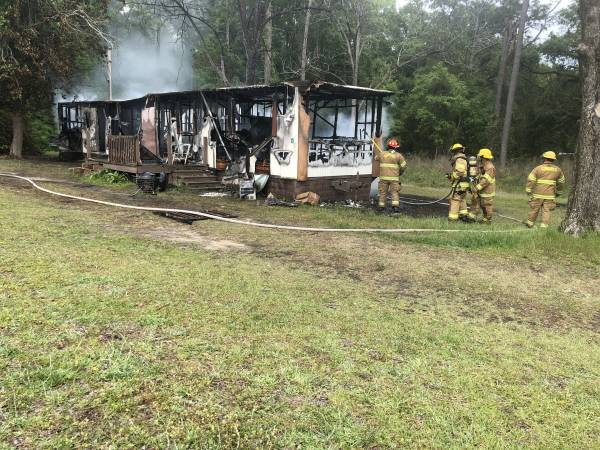 Two Men Passing By Save Man From Burning Mobile Home