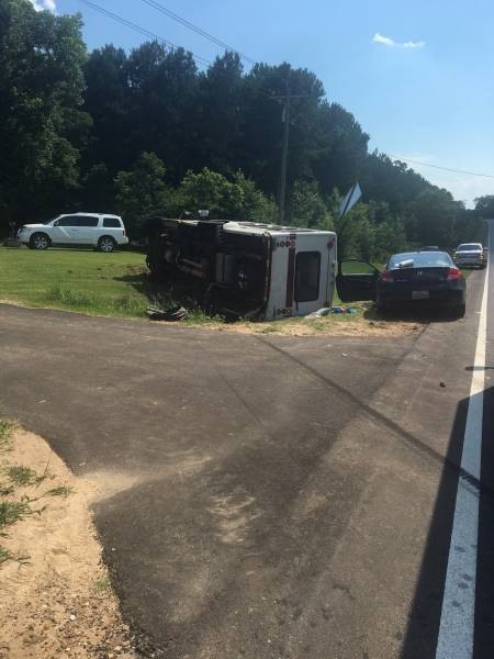 3:25 PM.  NOT A SCHOOL BUS - Wiregrass Transit Bus - Overturned In Coffee County