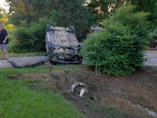 6:17 AM... Vehicle Overturned in Yard at 5625 Eddins Road