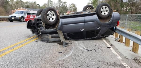 1:09PM..  Vehicle Overturned on Honeysuckle